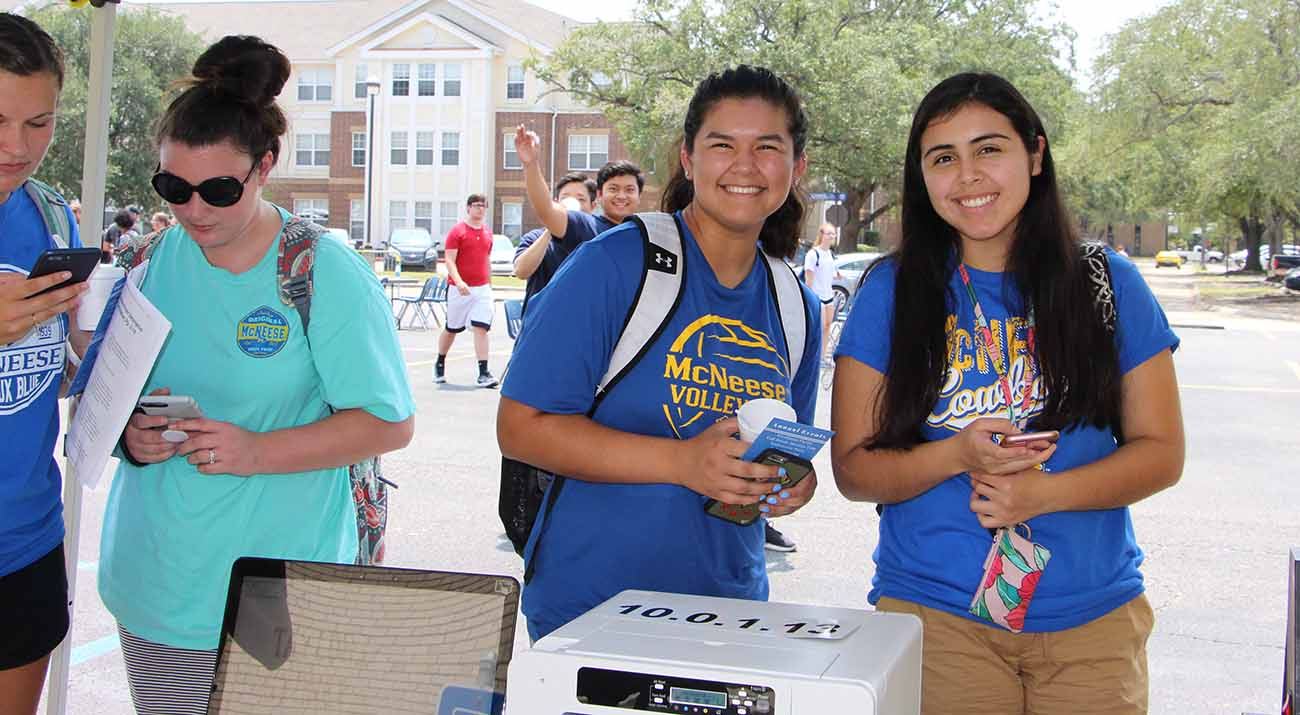 Two McNeese students smile for the camera while enjoying Howdy Rowdy Welcome Back events.