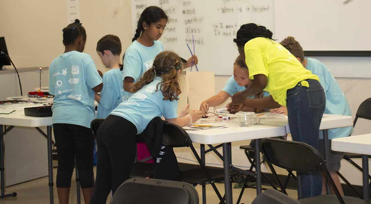 Students work together to complete an activity at STEM Academy.