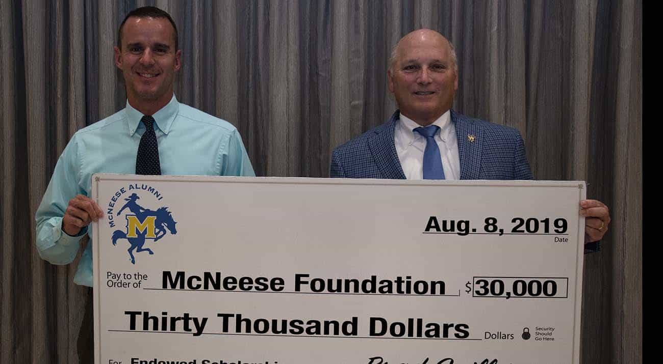 On hand for the donation are from left: Brad Guillory, president of the McNeese Alumni Association board of directors, and Dr. Daryl Burckel, McNeese president. McNeese Photo