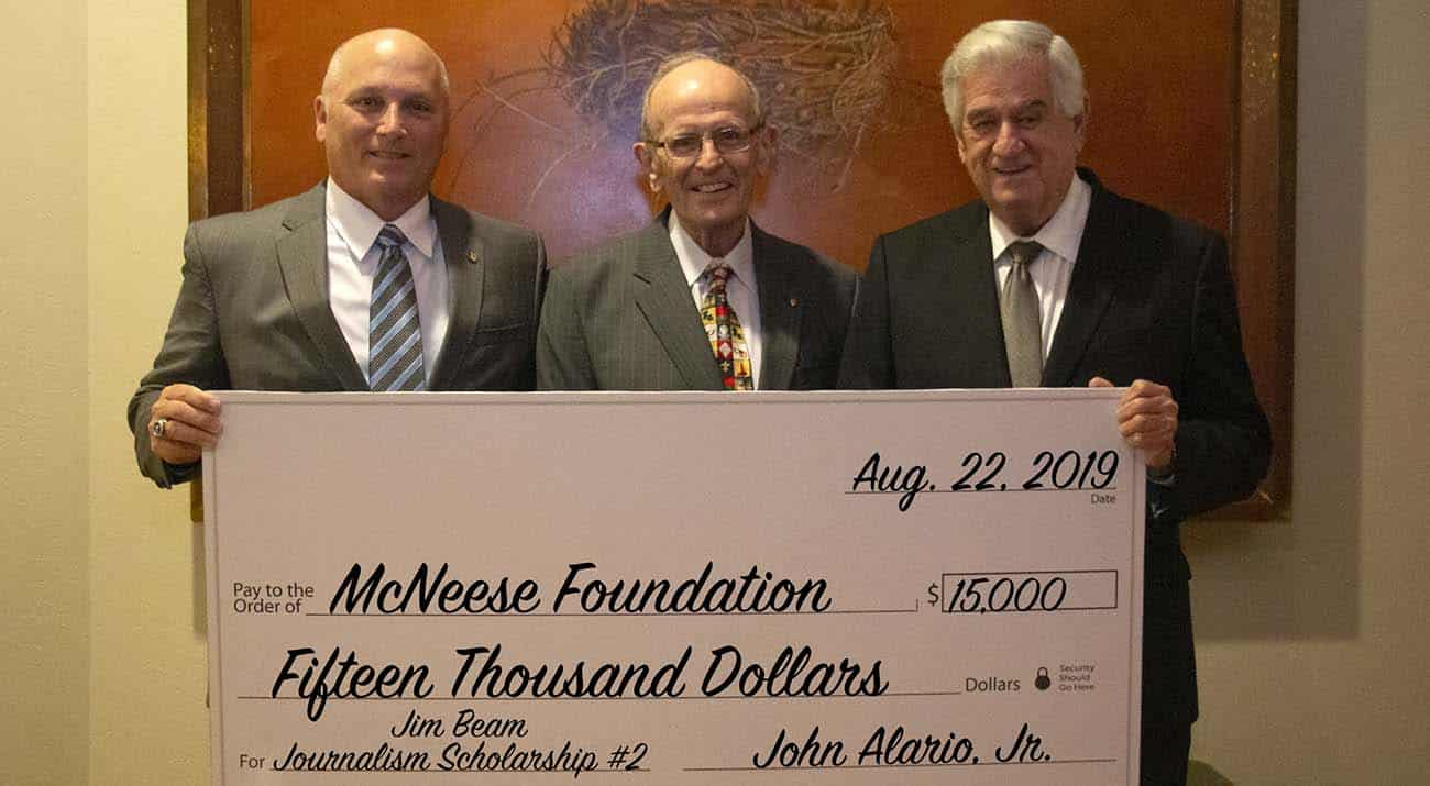 Dr. Daryl Burckel, McNeese president, Jim Beam, and John Alario Jr., Louisiana Senate president. McNeese Photo