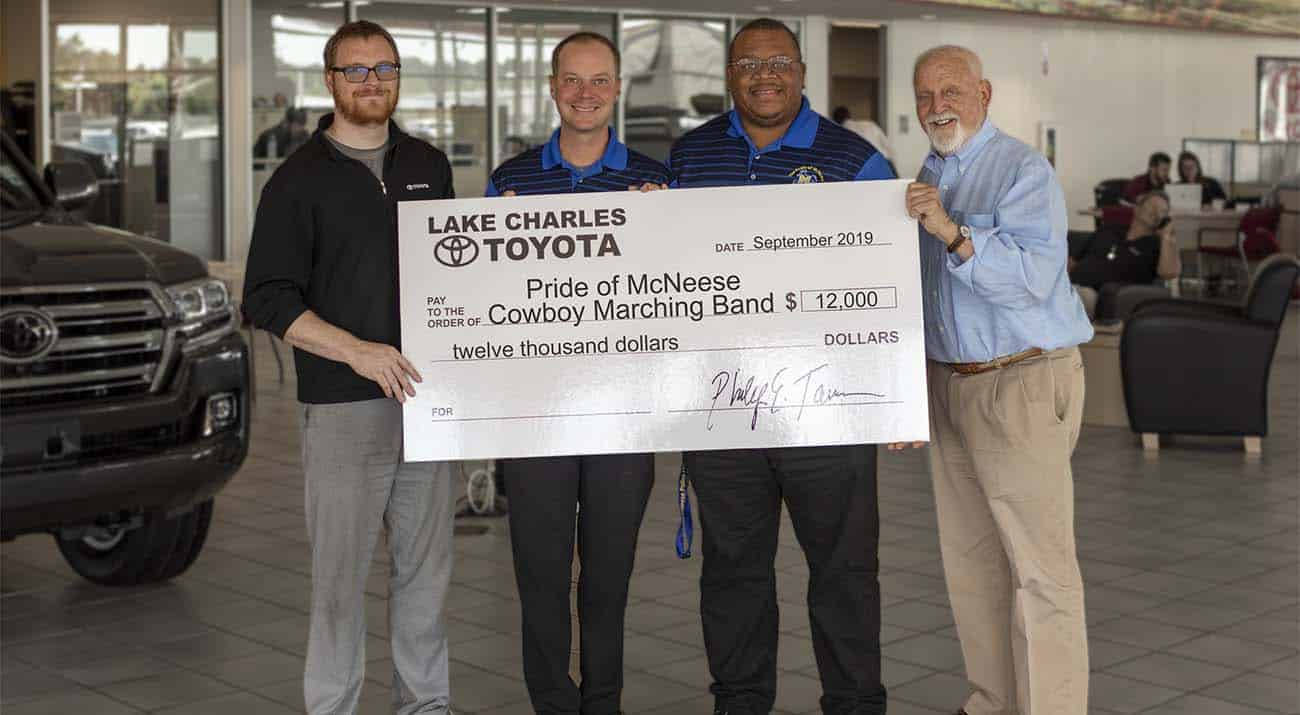 Corey Tarver, general manager of Lake Charles Toyota, Dr. Jay Sconyers, director of McNeese Bands, Dr. Jack Eaddy, assistant director of McNeese Bands, and Richard H. Reid, vice president for university advancement and executive vice president of the McNeese Foundation. McNeese Photo