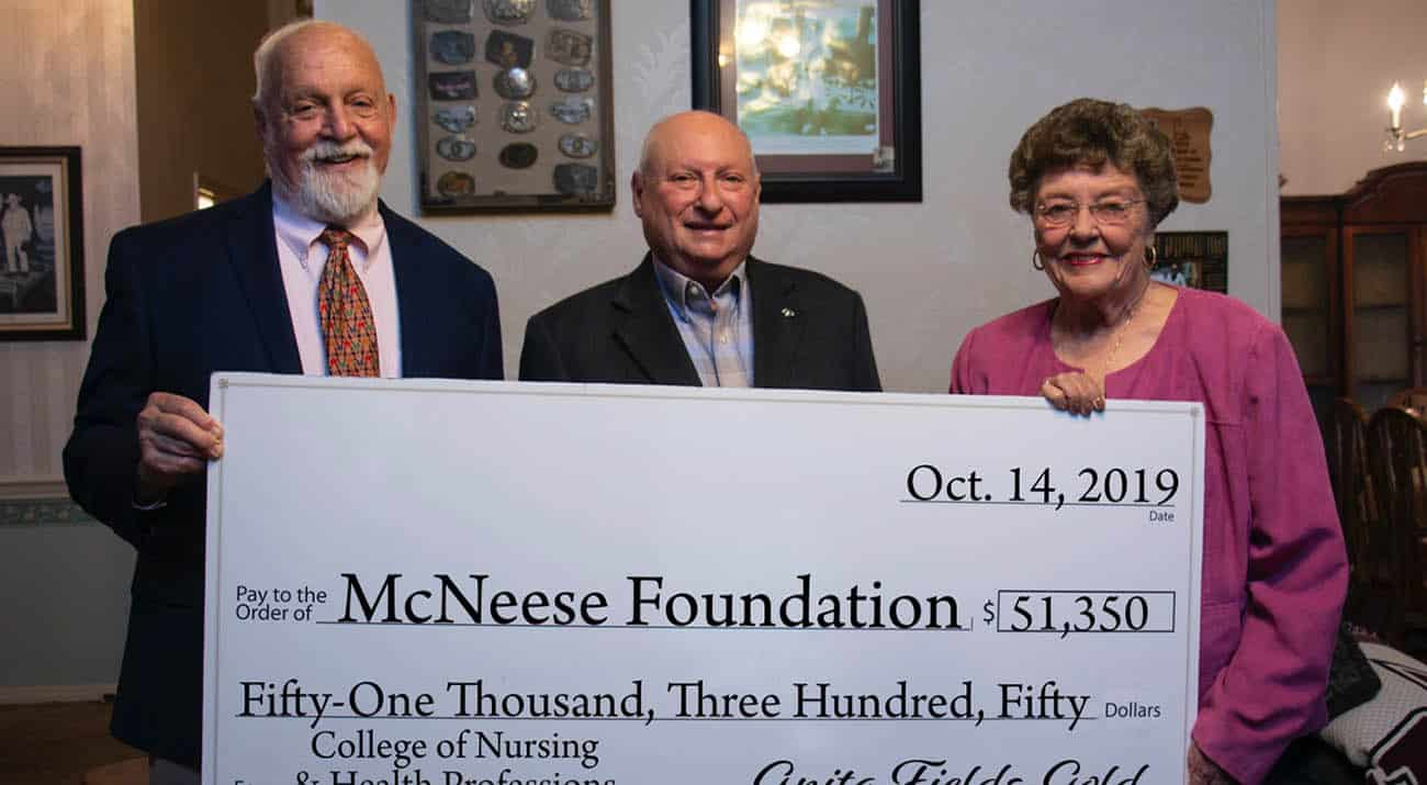 On hand for the donation are, from left, Richard H. Reid, vice president for university advancement and executive vice president for the McNeese Foundation, Maurice Gold and Dr. Anita Fields-Gold.