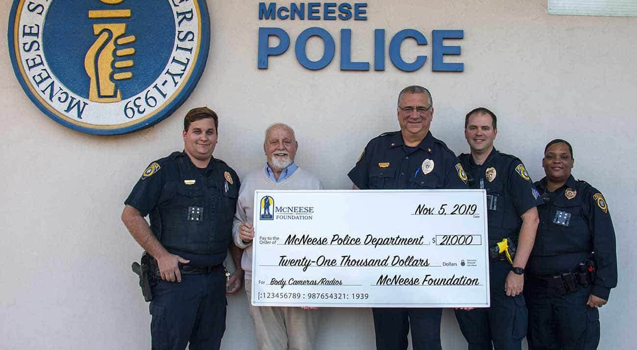 On hand for the donation are, from left: John Gill, McNeese police officer, Richard Reid, vice president for university advancement and executive vice president for the McNeese Foundation, Will Scheufens, McNeese chief of police, Tim Swim, McNeese police sergeant, and Stephanie Bryant, McNeese police officer.