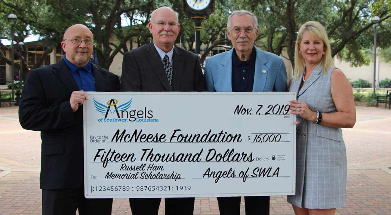 On hand for the donation are (from left to right): Dr. Mitchell Adrian, McNeese provost and vice president for academic affairs and enrollment management; Dr. Tim Hall, college dean; Ron McGinley, managing director for the Angels of Southwest Louisiana; and Angela Queenan, foundation board member.