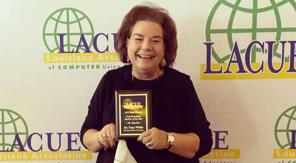 Dr. Faye White with her award