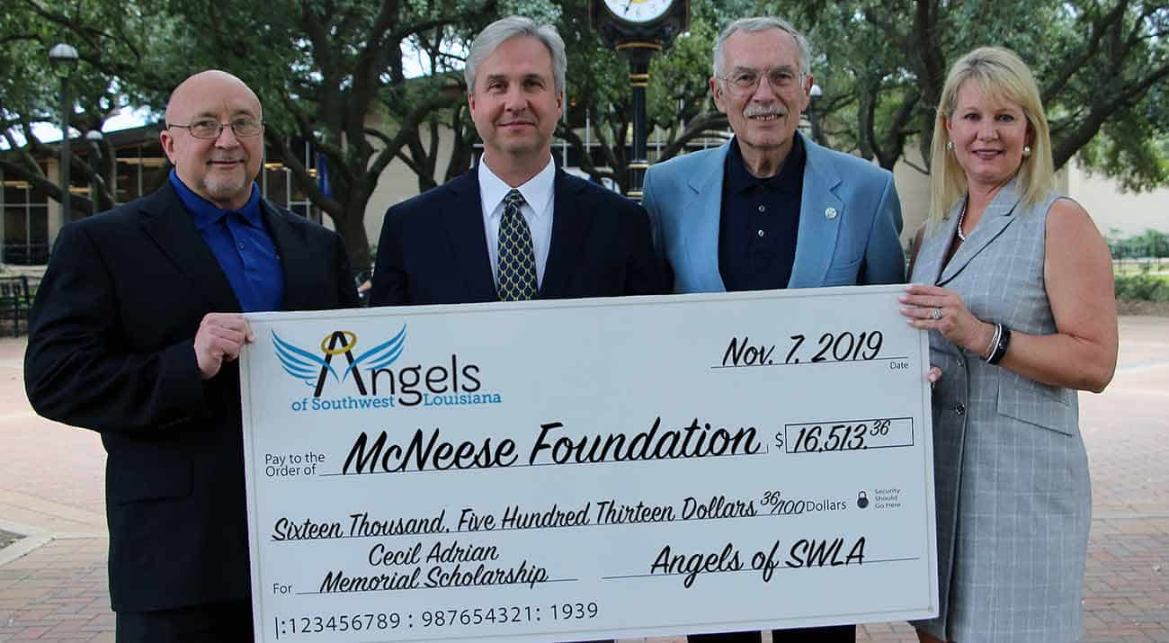 On hand for the donation are (from left to right): Dr. Mitchell Adrian, McNeese Provost and Vice President for Academic Affairs and Enrollment Management and Cecil Adrian's son; Dr. Wade Rousse, College Dean; Ron McGinley, Managing Director for the Angels of Southwest Louisiana; and Angela Queenan, Foundation Board Member.