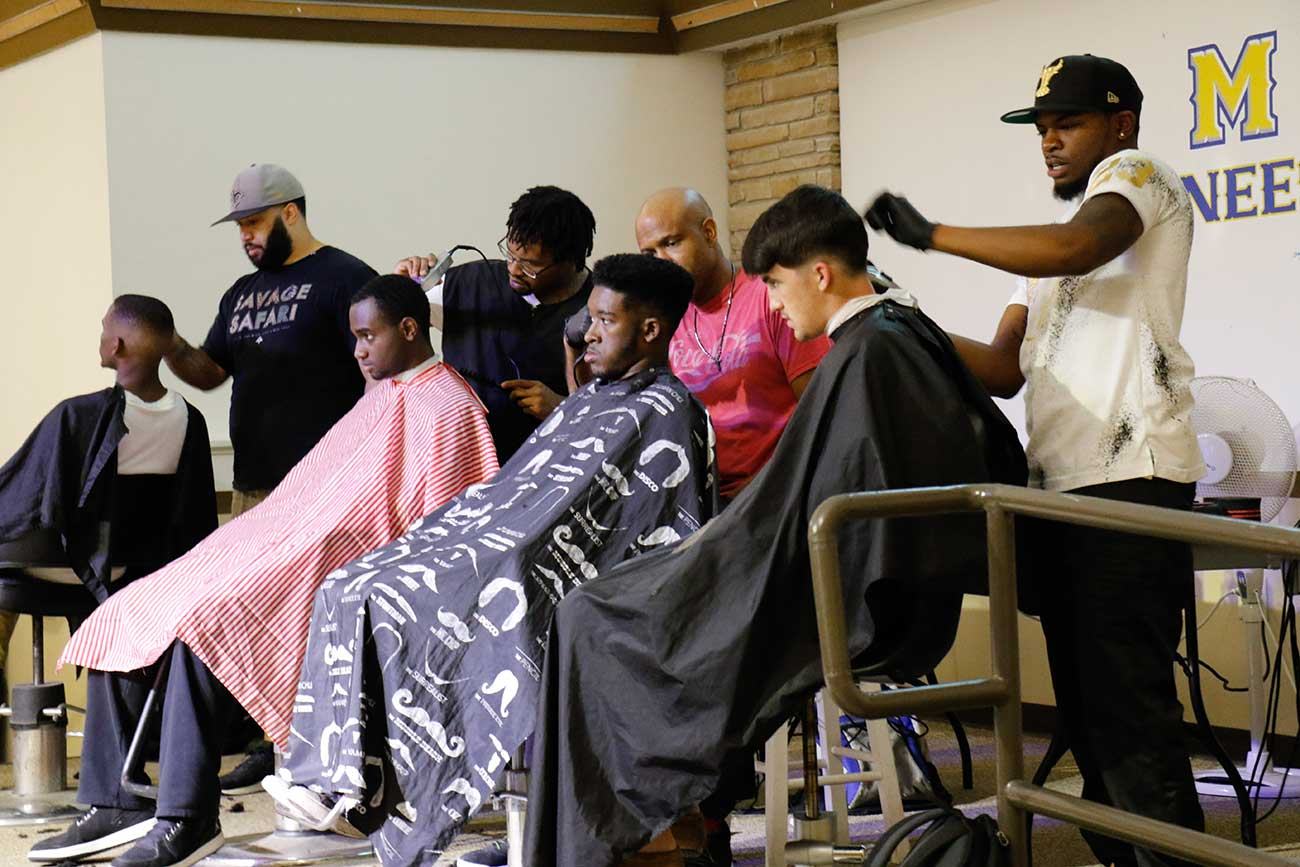 Students getting their hair cut at Rowdy's Barbershop