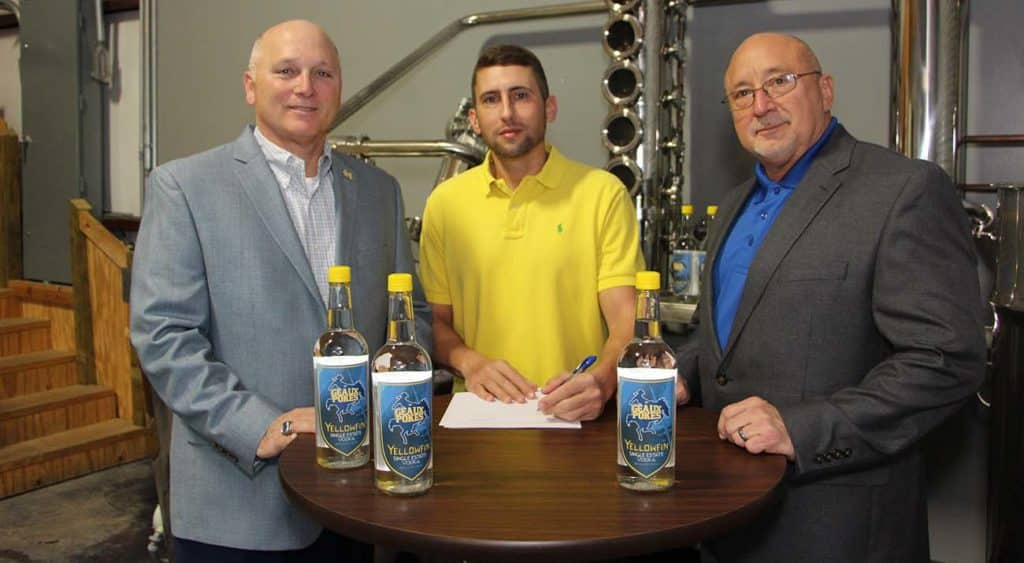 """McNeese State University has signed a marketing agreement with Yellowfin Distillery in Sulphur to receive a portion of the sale of a new beverage - Single Estate Vodka """"Geaux Pokes"""" Edition – that is currently available in area retail stores. On hand for the signing are, from left, Dr. Daryl Burckel, McNeese president, Jamison Trouth, McNeese graduate and president and CEO of Yellowfin Distillery, and Dr. Mitchell Adrian, McNeese provost and vice president for academic affairs and enrollment management."""