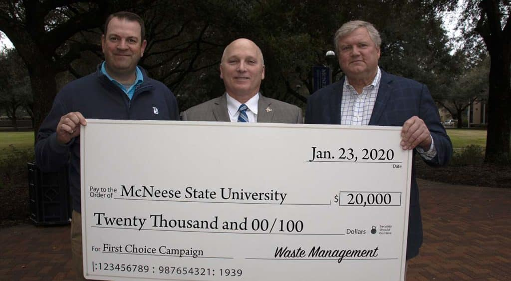 Waste Management officials Rene' Faucheux, Gulf Coast Area manager for government and community affairs, and Todd Washburn, Gulf Coast Area director for disposal operations, presented the second installment of a three-year pledge to McNeese State University President Dr. Daryl Burckel.