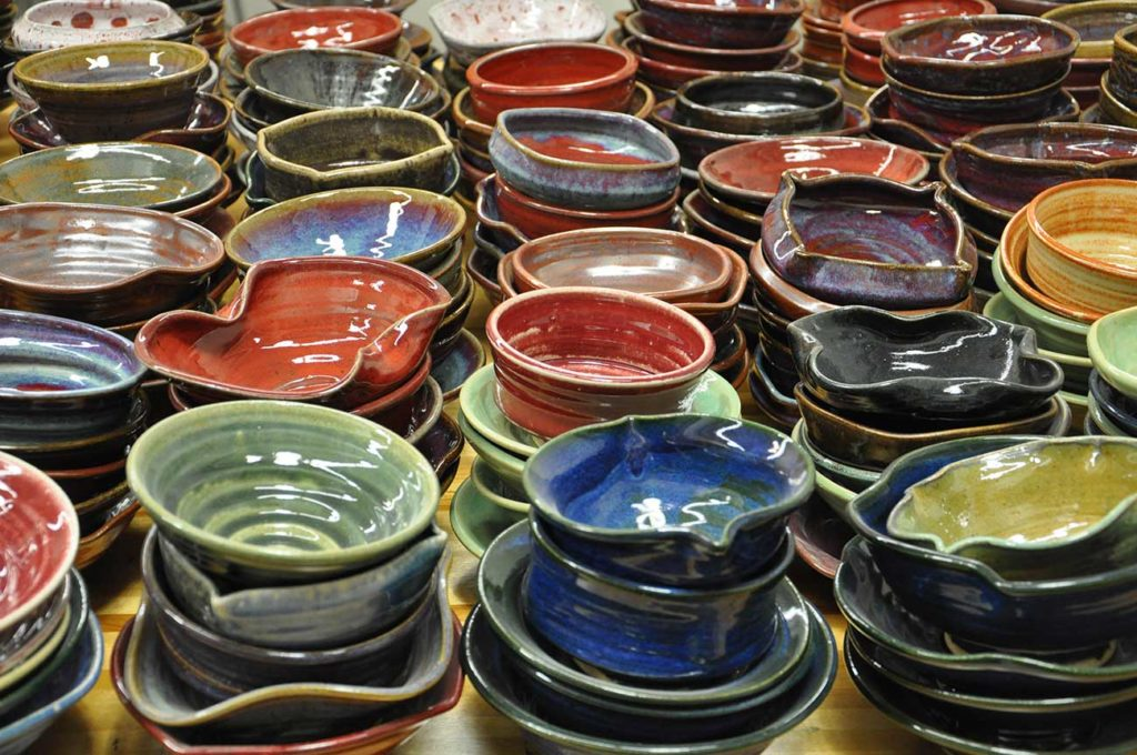 Ceramic bowls made by students and faculty