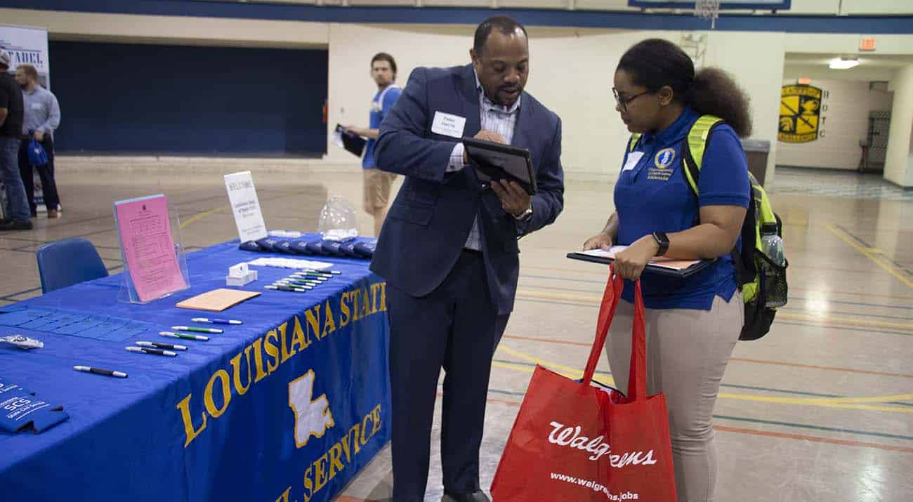 A recruiter goes over job descriptions with a McNeese students