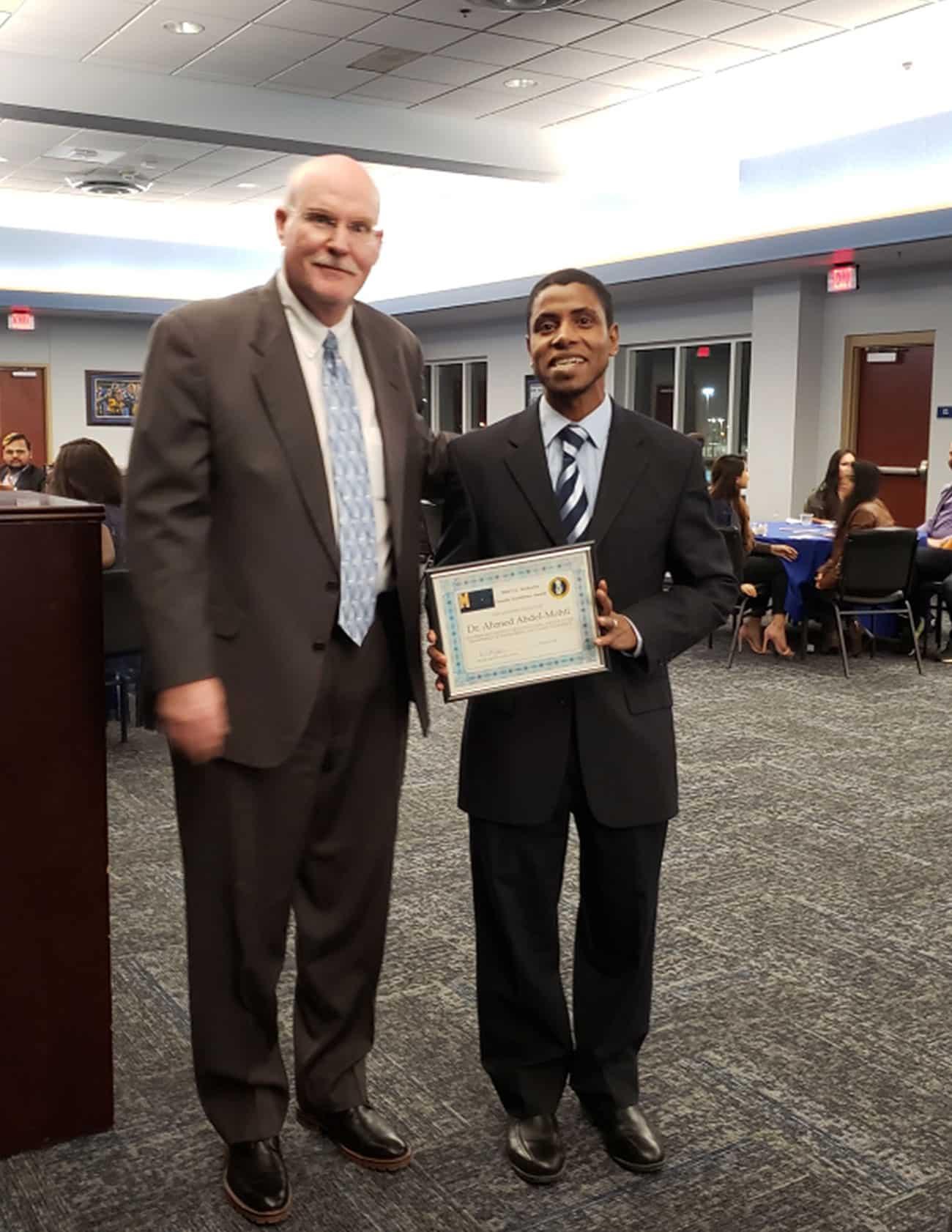 Dr. Hall presents faculty award