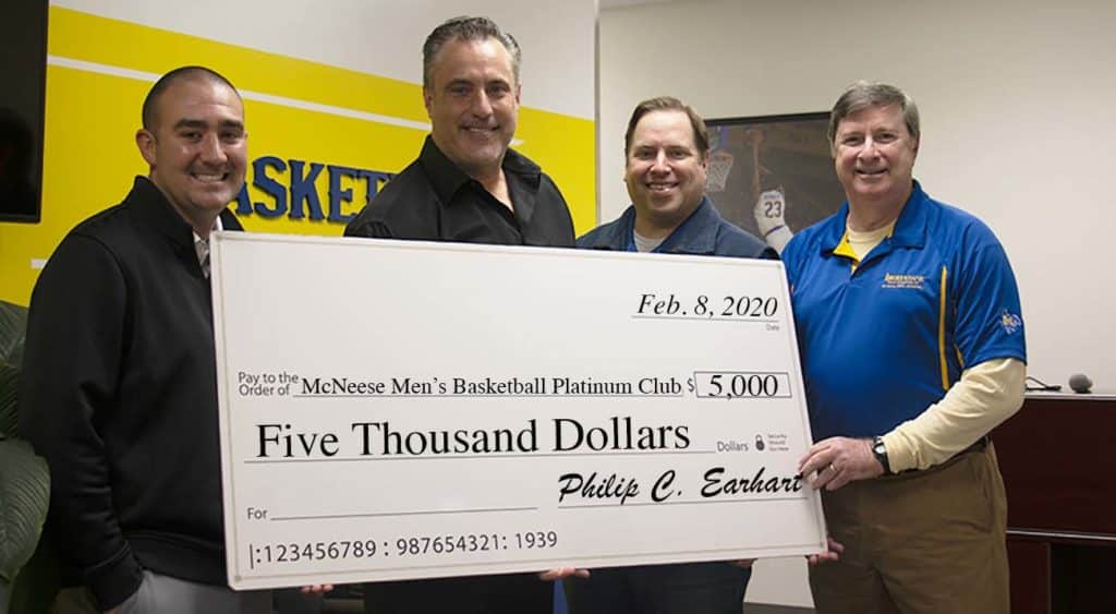 Left to right: Tanner Stines, Interim McNeese Athletics Director, Heath Schroyer, McNeese Men's Basketball Head Coach, Jason Martinez, IBERIABANK Retail Market Manager and Commercial Relationship Manager, and Phil Earhart, IBERIABANK Southwest Louisiana Market President.