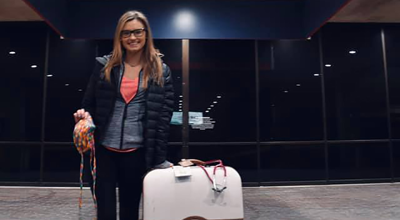 Sydnie Sutherland outside the airport before heading to New York.