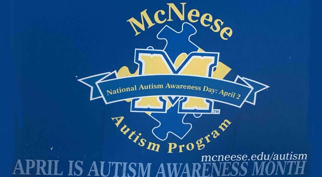 A yard sign with the MAP logo highlights National Autism Month.