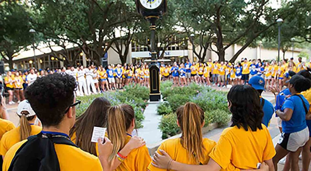 McNeese hosts Cowboy Camp for incoming freshman. Here students gather around the quad clock for 19:39