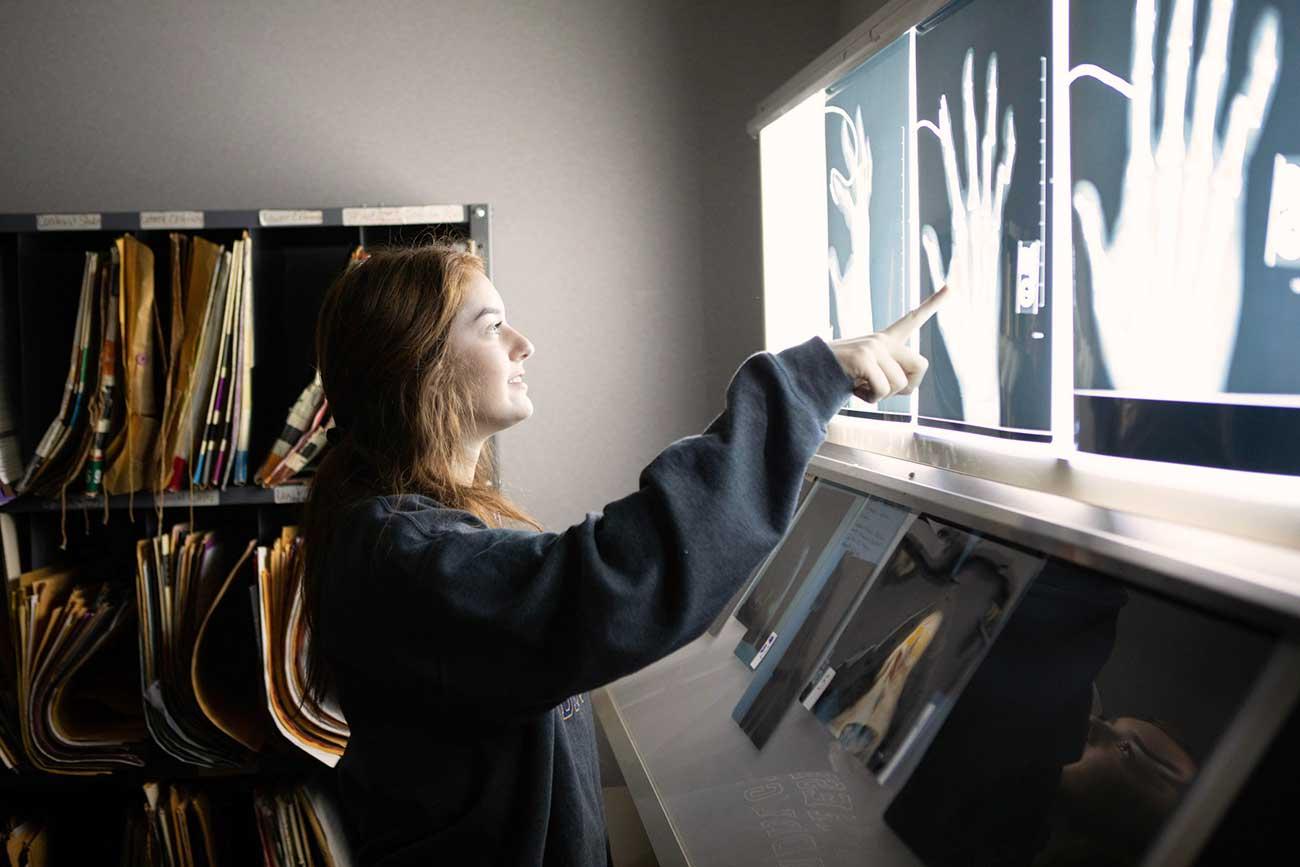 Student examining X Rays