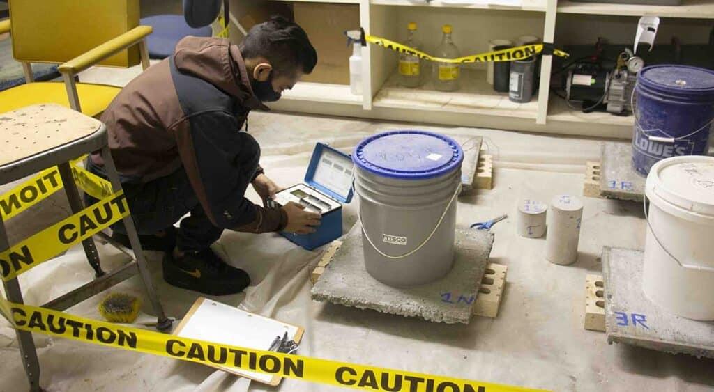 Shreewan Rupakheti reviews his concrete samples.