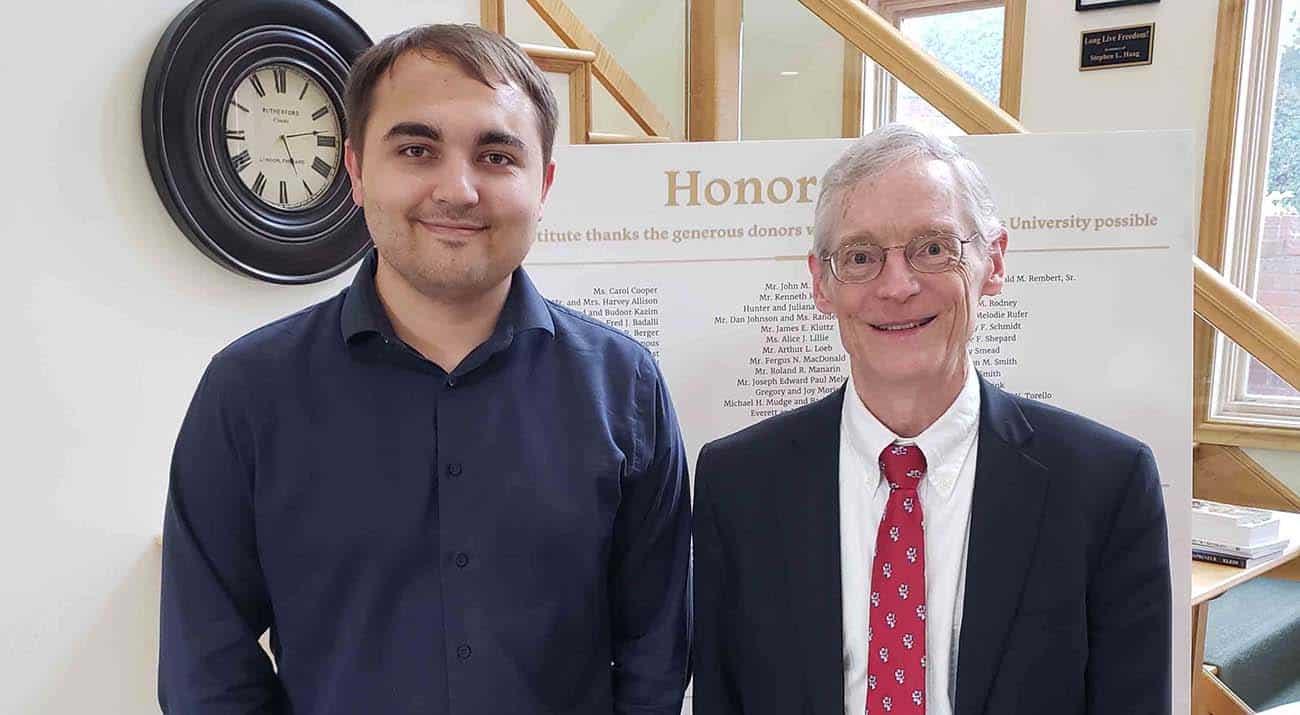 Recent McNeese graduate Devin Cooper, left, and Dr. Jeffrey Herbener, Economics Department Chair at Grove City College, at the Mises University program.