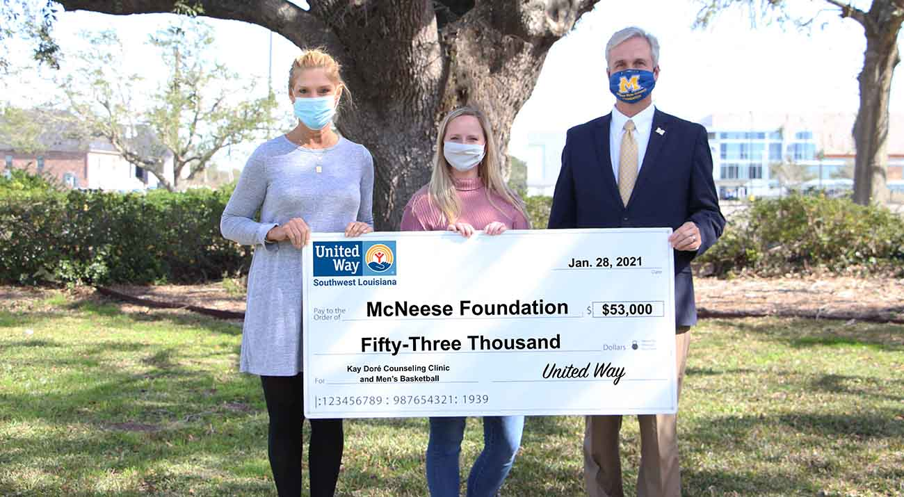 On hand for the presentation are, from left, Denise Durel, United Way of Southwest Louisiana President and CEO, Caitlyn Kudrecki, Suicide Prevention Program Coordinator for the Kay Doré Counseling Clinic, and Dr. Wade Rousse, Vice President for University Advancement and Dean of the College of Business.