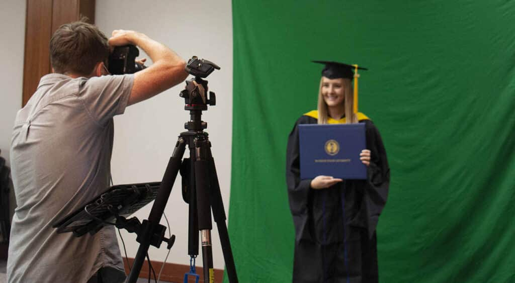 A masters degree student has her photo taken at gradfest.