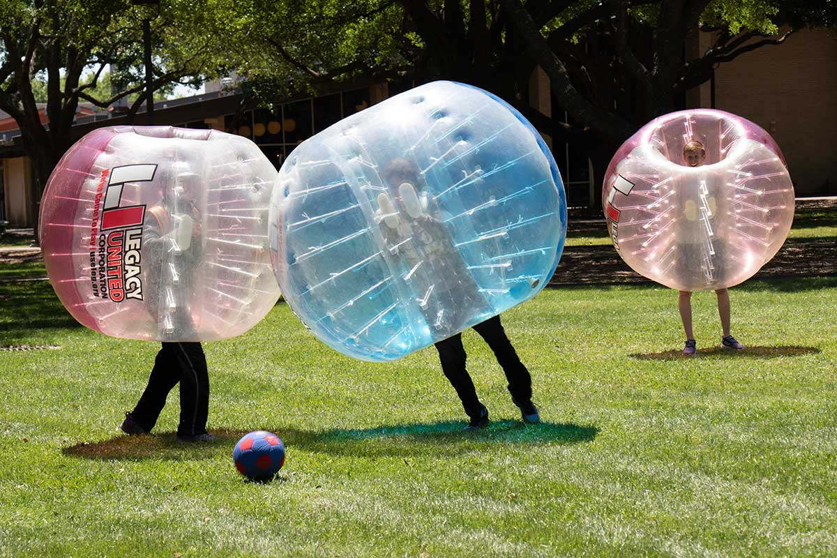 Students playing bubble soccer at Mcneese State University, one of the best universities in Louisiana