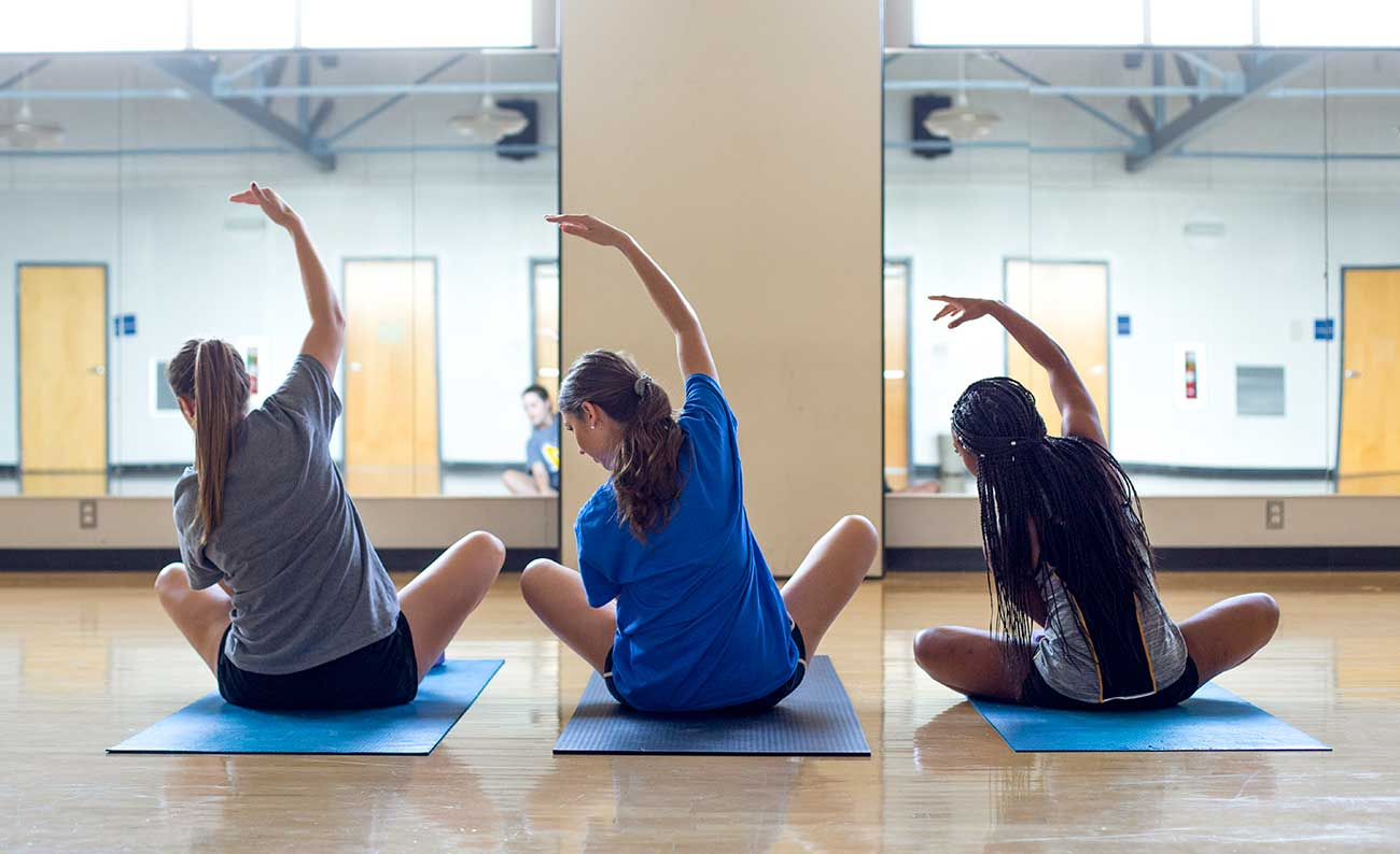 Students practice yoga at McNeese State University, one of the best universities in Louisiana