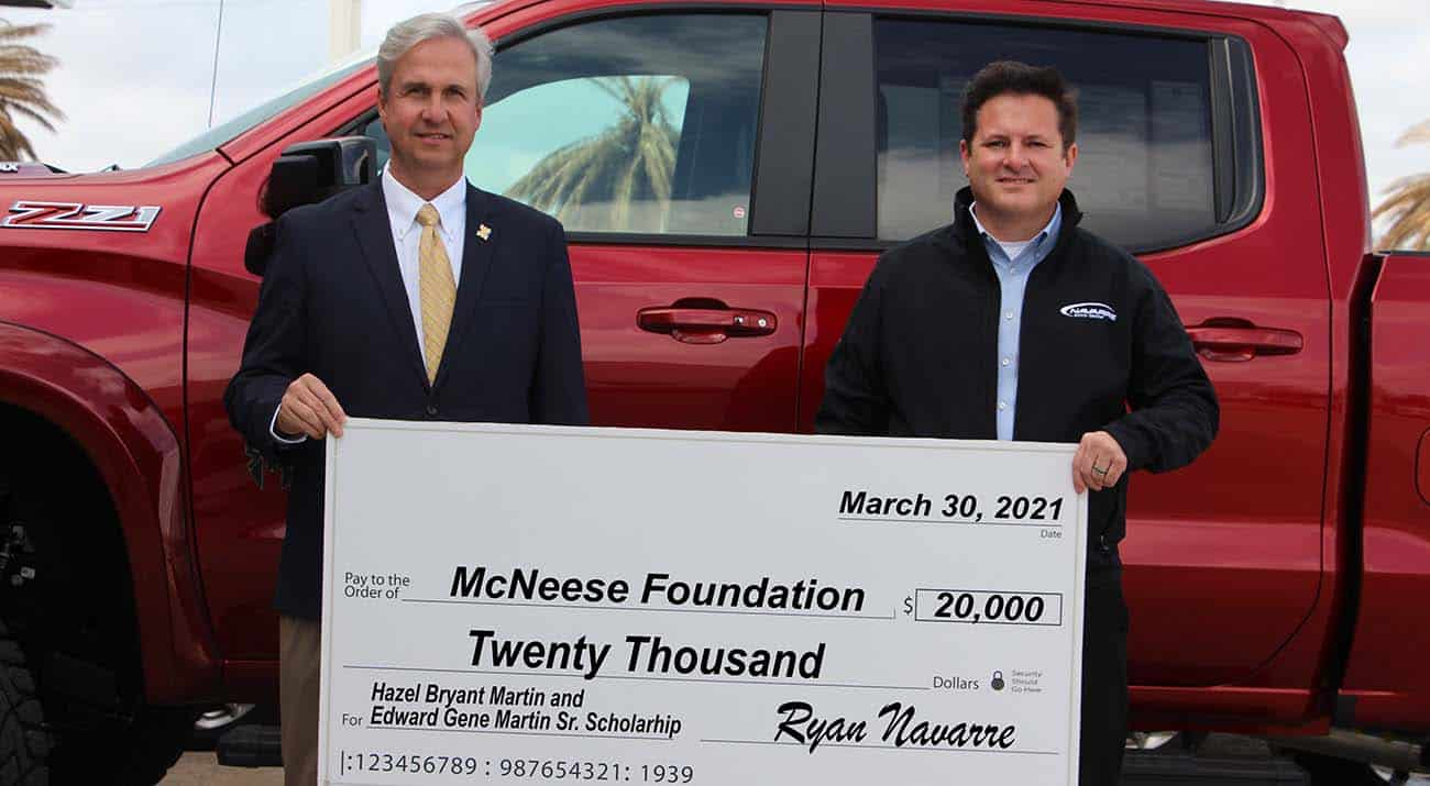 On hand for the donation are, from left, Dr. Wade Rousse, vice president for university advancement and dean of the college of business, and Ryan Navarre, dealer for Navarre Automotive.