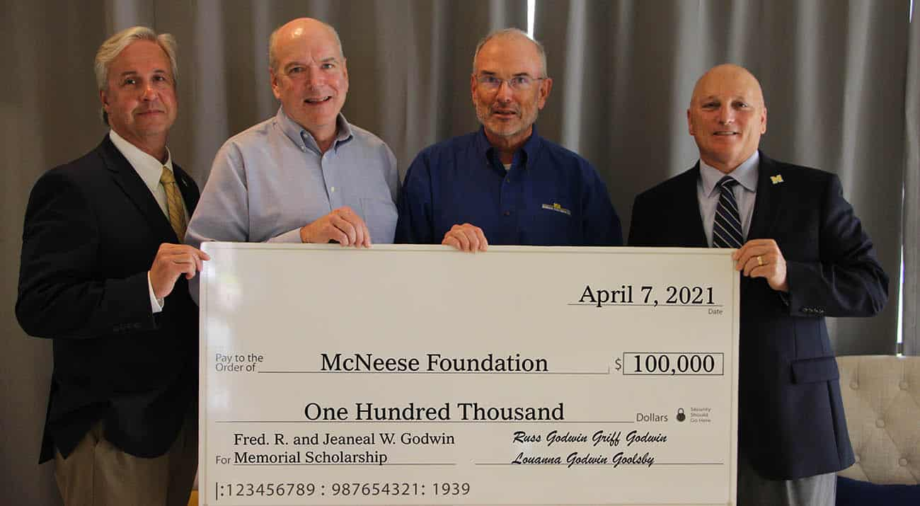 On hand for the presentation are, from left, Dr. Wade Rousse, McNeese vice president for university advancement and dean of the college of business, Griff and Russ Godwin and Dr. Daryl Burckel, McNeese president. McNeese Photo
