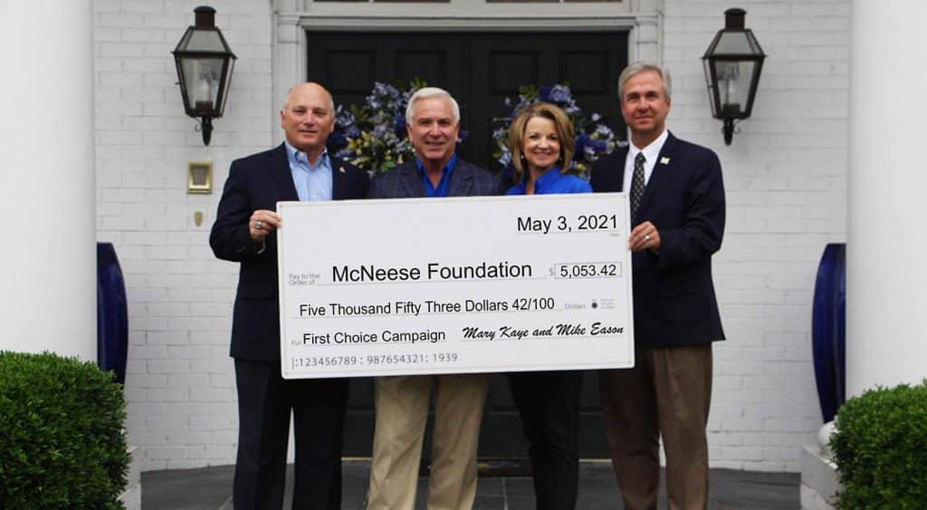 On hand for the presentation are, from left, Dr. Daryl Burckel, McNeese President, Mike and Mary Kaye Eason and Dr. Wade Rousse, McNeese Vice President for University Advancement and Dean of the College of Business.