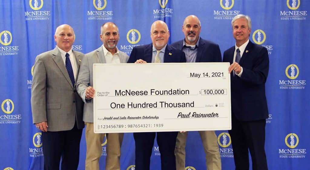On hand for the presentation are, from left, Dr. Daryl Burckel, McNeese President, Darrell, Paul and Steven Rainwater, and Dr. Wade Rousse, Vice President for University Advancement and Dean of the College of Business.