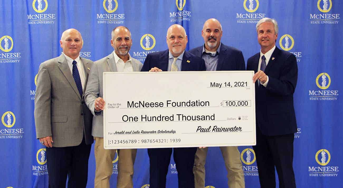 On hand for the presentation are, from left, Dr. Daryl Burckel, McNeese president, Darrell, Paul and Steven Rainwater, and Dr. Wade Rousse, vice president for university advancement and dean of the college of business. McNeese Photo