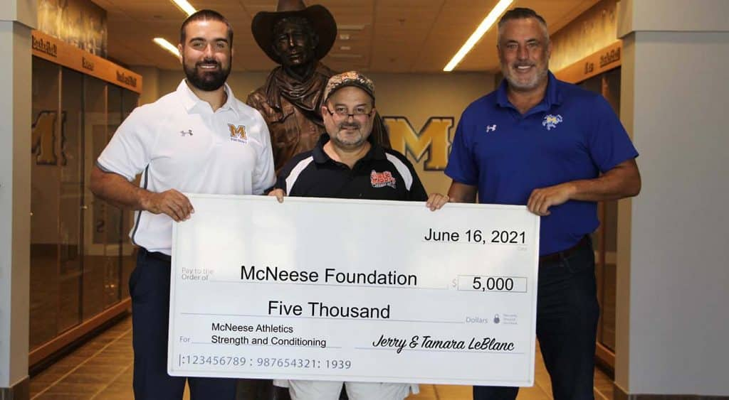 On hand for the presentation are, from left, Jimmie Bunting, McNeese director of strength and conditioning, Jerry LeBlanc, owner of Big Daddy's, and Heath Schroyer, McNeese athletics director. McNeese Photo