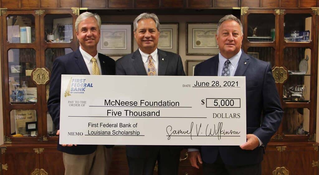 On hand for the donation are, from left, Dr. Wade Rousse, McNeese vice president for university advancement, Charles Timpa, First Federal chairman of the board and CEO, and Samuel V. Wilkinson, First Federal president. McNeese Photo