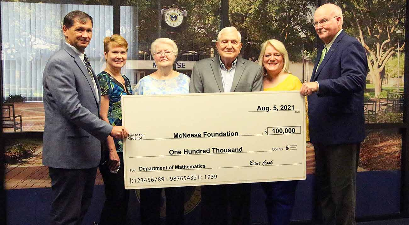 On hand for the donation are, from left, Dr. Chip LeMieux, interim vice president for academic affairs and enrollment management, Dr. Karen Aucoin, mathematics department head, Bane's wife, Gay, Bane, Bane's daughter, Lisa Ann Cook Simpson, a 1983 accounting graduate, and Dr. Tim Hall, dean of the college of science, engineering and mathematics.