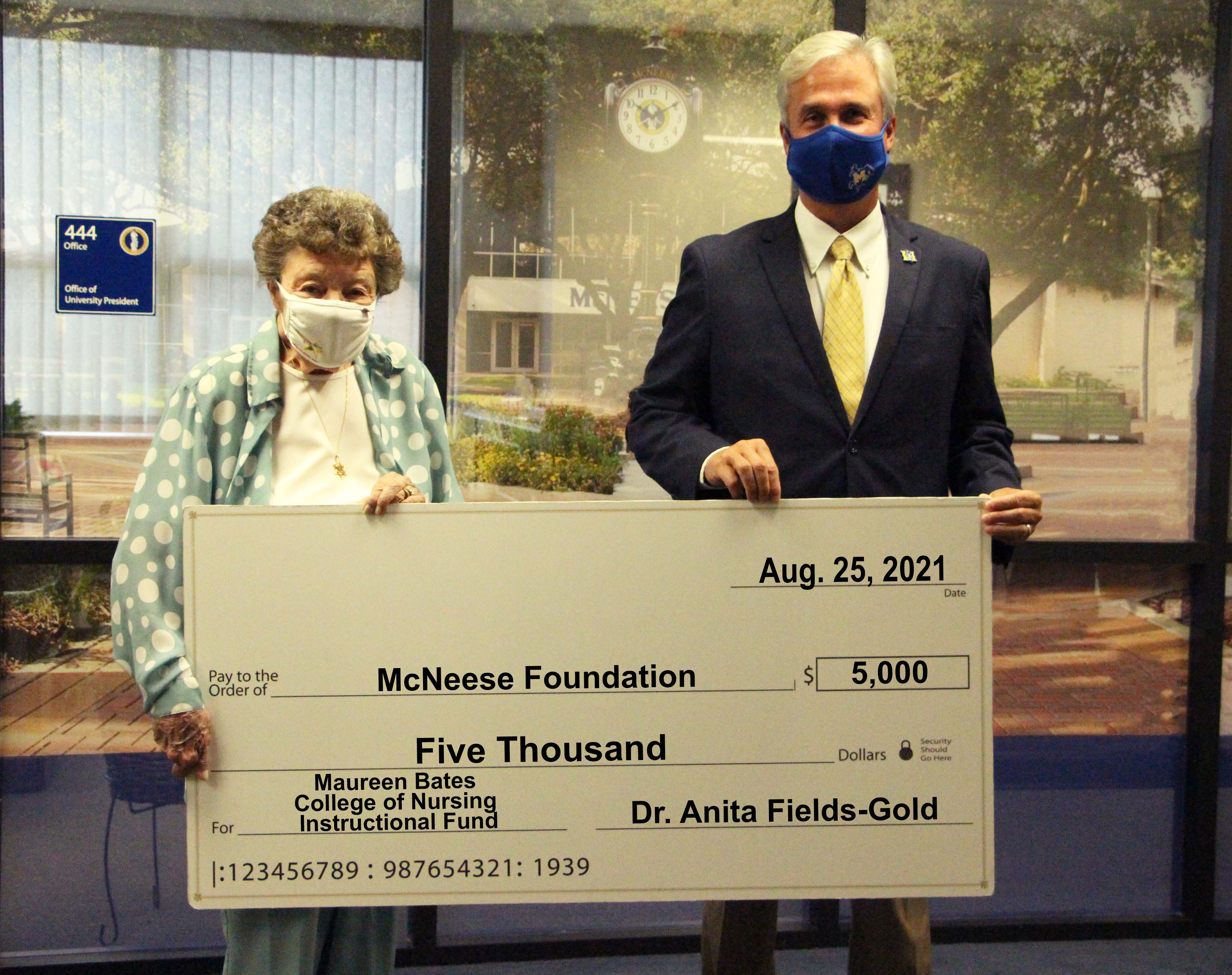 On hand for the donation are, from left, Fields-Gold and Dr. Wade Rousse, McNeese vice president for university advancement. McNeese Photo